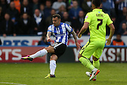 Sheffield Wednesday midfielder Ross Wallace (33) shoots during the Sky Bet Championship Play Off First Leg match between Sheffield Wednesday and Brighton and Hove Albion at Hillsborough, Sheffield, England on 13 May 2016.