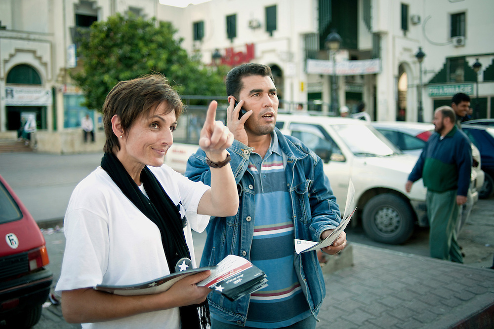 Tunis, Tunisia 17 October 2011<br /> Monia Ayari, Member of the coalition &quot;Modern Democratic Pole&quot; gives flyers promoting the program of her party.<br /> Photo: Ezequiel Scagnetti