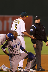 June 14, 2011; Oakland, CA, USA;  Oakland Athletics manager Bob Melvin (6) argues a call at third base with MLB umpire Mike Estabrook (83) in front of Kansas City Royals shortstop Alcides Escobar (2) during the eighth inning at Oakland-Alameda County Coliseum.
