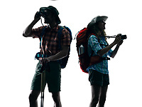 one caucasian couple trekker trekking Photographing nature in silhouette isolated on white background