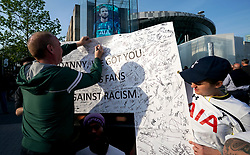 Tottenham Hotspur's Fans sign a banner in support of  Danny Rose prior to the match
