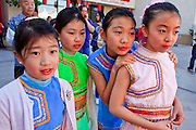 """14 FEBRUARY 2010 - PHOENIX, AZ: Girls watch a traditional performance during the Chinese New Year celebration in Phoenix, AZ. This marks the Chinese """"Year of the Tiger."""" The Chinese New Year Celebration at the COFCO Chinese Cultural Center in Phoenix attracted thousands of people. The celebration featured traditional Chinese entertainment and food.  PHOTO BY JACK KURTZ"""