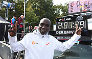 Eliud Kipchoge (KEN) poses with finish clock after winning the 45th Berlin Marathon in a world best 2:01.39 in Berlin, Germany, Sunday, Sept. 16, 2018.. Kipchoge  broke the previous record by 1:18 set in 2014  by Dennis Kimetto. It is the largest single improvement on the marathon world record since Derek Clayton improved the mark by 2:23 in 1967. (Jiro Mochizuki/Image of Sport)