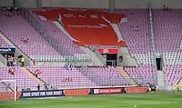 Fussball International  WM Qualifikation 2014   in Genf   Schweiz - Zypern         09.06.2013 Stadion Uebersicht im Stade de Geneve; uebergrosses Schweizer Nationaltrikot auf der Tribuene