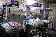 Babies lie in the Neonatal Intensive Care Unit (NICU) at the Apara Nursing Home, where babies from the Akanksha clnic are often sent for neonatal and other post-birth intensive care, in Anand, Gujarat, India on 10th December 2012. Photo by Suzanne Lee / Marie-Claire France