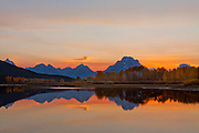 Oxbow Bend along the Snake River ablaze in the warm colors of dusk, Grand Teton National Park