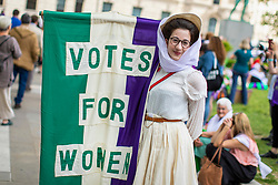 © Licensed to London News Pictures. 10/06/2018. London, UK. People gather in Parliament Square after thousands of people marched through central London wearing green, white and violet, the colours of the Suffragette movement,  to celebrate 100 years votes for women. Photo credit: Rob Pinney/LNP