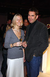 SUSIE FORBES editor of Easy living magazine and BILL AMBERG the bag designer at a party to celebrate the launch of You Magazine as a paid for weekly held at 2-5 Rupert Street, London W1 on 14th March 2006.<br />