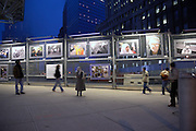 """here. remembering 9/11"" memorial, world trade center, new york city. The shot of the exhibit illustrates the symmetry of the art and the observers"