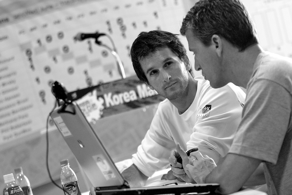 Mathieu Richard talks with Pierre Orphanidis Korea Match Cup 2010. World Match Racing Tour. Gyeonggi, Korea. 11th June 2010. Photo: Ian Roman/Subzero Images.
