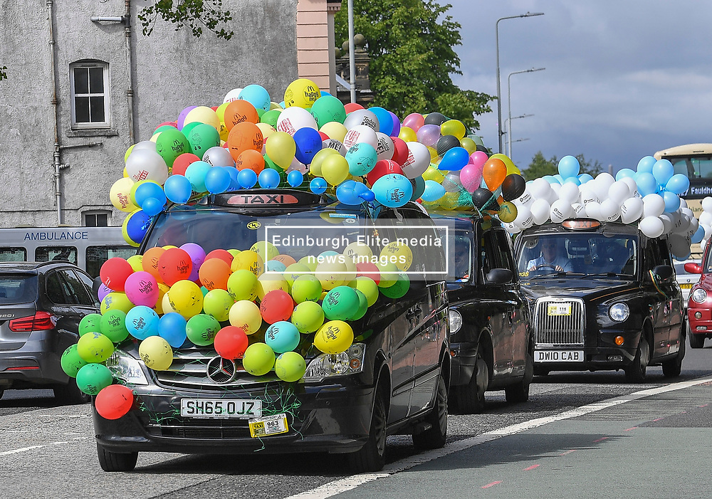 Dozens of brightly decorated taxis took part in the annual children's outing, where children with special needs go out on a run in the taxis.<br /> <br /> © Dave Johnston / EEm