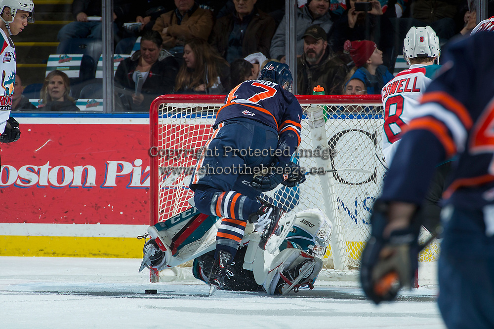 KELOWNA, CANADA - DECEMBER 27: Brodi Stuart #17 of the Kamloops Blazers collides into the net of James Porter #1 of the Kelowna Rockets during first period on December 27, 2017 at Prospera Place in Kelowna, British Columbia, Canada.  (Photo by Marissa Baecker/Shoot the Breeze)  *** Local Caption ***