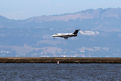 Embraer Phenom 300 (N361FX) landing at San Francisco International Airport (KSFO), San Francisco, California, United States of America