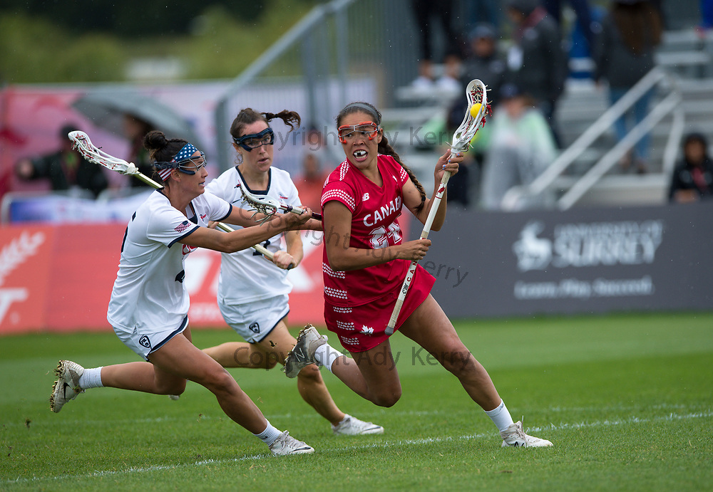 USA's Marie McCool and Jennifer Russell challenges with Canada's Alie Jimerson  during the World Cup Final at the 2017 FIL Rathbones Women's Lacrosse World Cup, at Surrey Sports Park, Guildford, Surrey, UK, 22nd July 2017.