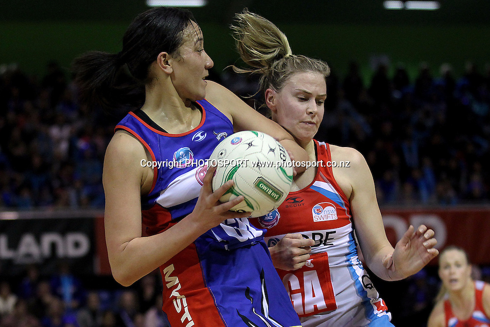 Mystics' Rachel Rasmussen clashes with Swifts' Amorette Wild. ANZ Netball Championship, Northern Mystics v NSW Swifts, Trusts Stadium, Auckland, New Zealand. Sunday 1st July 2012. Photo: Anthony Au-Yeung / photosport.co.nz
