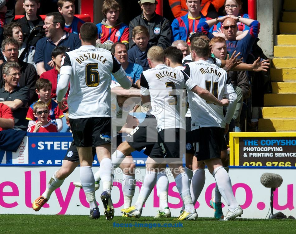 Picture by Alan Stanford/Focus Images Ltd +44 7915 056117.04/05/2013. Peterborough United players celebrate their goal during the npower Championship match at Selhurst Park, London...