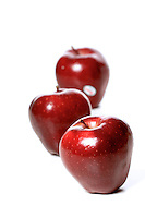 Studio soht of red apples on white background