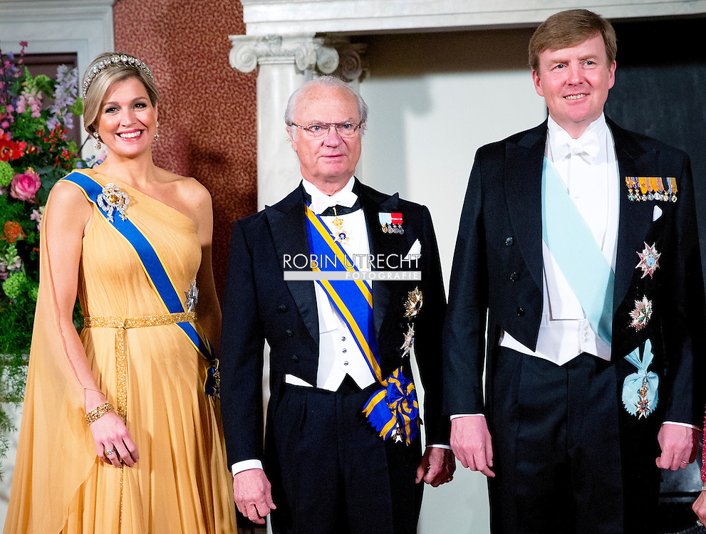 AMSTERDAM 04-04-2014 Audience Arrival of Queen Silvia and King Carl-Gustaf for an audience with Queen Maxima and King Willem-Alexander at the Koninklijk palace in Amsterdam. <br /> COPYRIGHT ROBIN UTRECHT