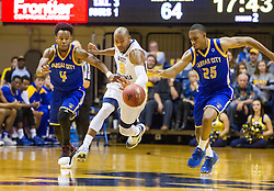 Dec 17, 2016; Morgantown, WV, USA; West Virginia Mountaineers guard Jevon Carter (2) fights for a loose ball with UMKC Kangaroos guard LaVell Boyd (4) and UMKC Kangaroos guard Broderick Newbill (25) during the second half at WVU Coliseum. Mandatory Credit: Ben Queen-USA TODAY Sports