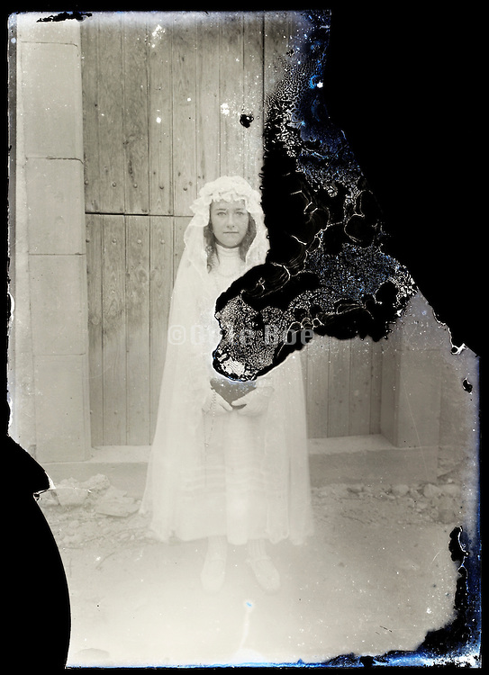 eroding glass plate photo of young girl in holy communion clothing