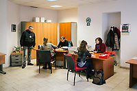 "NAPLES, ITALY - 9 NOVEMBER 2018: Unemployed citizens register to the Eastern Naples Job Center in Naples, Italy, on November 9th 2018.<br /> <br /> Italy's 550 state-run job centers will be in charge of verifying that recipients of the ""citizens' wage"", a welfare policy championed by the governing 5-Star Movement designed to lift 5 million Italian out of poverty, meet an important eligibility criteria: that they are actively looking for a job.<br /> But Italians widely regard the centers as being blighted by obsolete technology and insufficient and under-qualified staff. The new populist government plans to spend 1 billion euros to modernize the centers — 10 percent of the total cost of the new policy in its first year in 2019. <br /> <br /> The ""citizens' wage"" will cost 10 billion euros next year, the most expensive item in a big-spending budget which itself has raised concerns in the European Union that Italy could be sowing the seeds of a financial crisis."