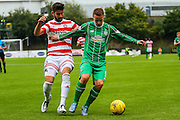 Celtic FC Forward Leigh Griffiths hold up Hamilton Academical Defender Jesus Garcia Tena during the Ladbrokes Scottish Premiership match between Hamilton Academical FC and Celtic at New Douglas Park, Hamilton, Scotland on 4 October 2015. Photo by Craig McAllister.
