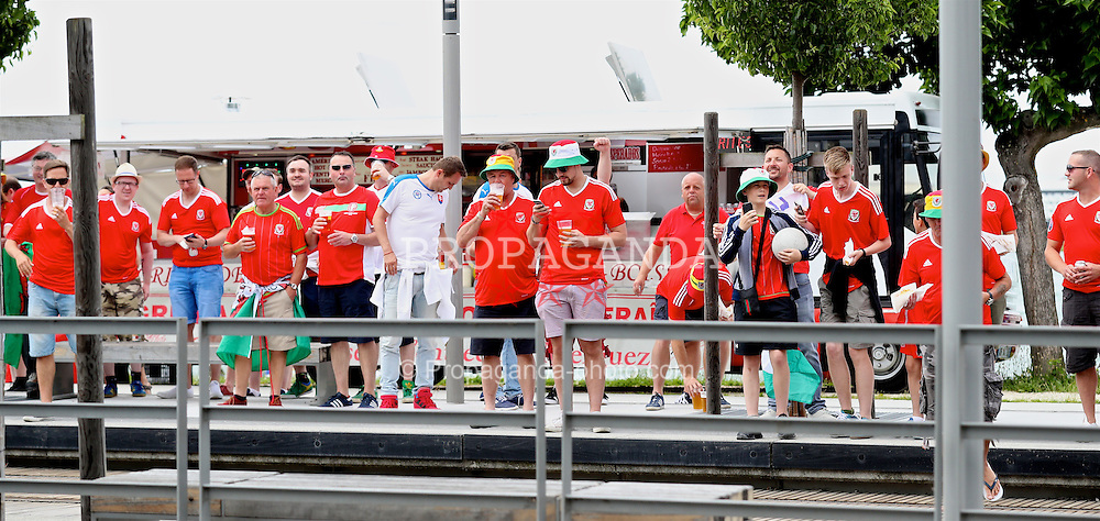BORDEAUX, FRANCE - Saturday, June 11, 2016: Wales supporters watch the squad during a pre-match team walk outside the team hotel ahead of the UEFA Euro 2016 Championship against Slovakia. (Pic by David Rawcliffe/Propaganda)