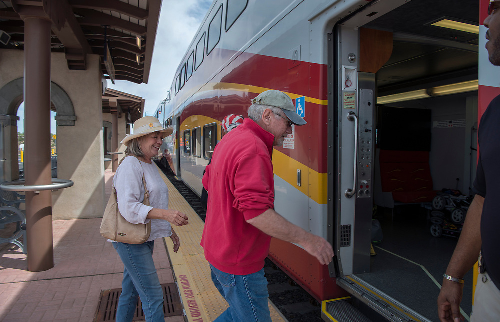 em042417b/a/George and Rebecca Heindel, from Santa Fe, get ready to board the New Mexico Rail Runner Express at the Zia Road Station to ride it to the Santa Fe Depot, Monday April 24, 2017. On Monday the Zia Station officially opened. (Eddie Moore/Albuquerque Journal