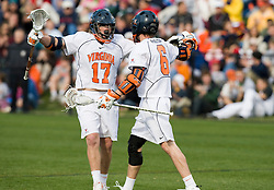 Virginia midfielder Mike Thompson (17) celebrates with Virginia attackman Ben Rubeor (6) after a goal.  The #2 ranked Virginia Cavaliers defeated the #6 ranked Johns Hopkins Blue Jays 13-12 in overtime at the University of Virginia's Klockner Stadium in Charlottesville, VA on March 22, 2008.  The loss, in front of a record UVA crowd of 7,500, was the third consecutive overtime defeat for Hopkins, the defending national champions.