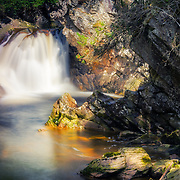 Sunlit view of the upper falls of Bruar, Pitagowan, Perth and Kinross