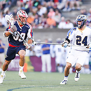 Paul Rabil #99 of the Boston Cannons keeps the ball from Ryan Flanagan #24 of the Charlotte Hounds during the game at Harvard Stadium on May 17, 2014 in Boston, Massachuttes. (Photo by Elan Kawesch)