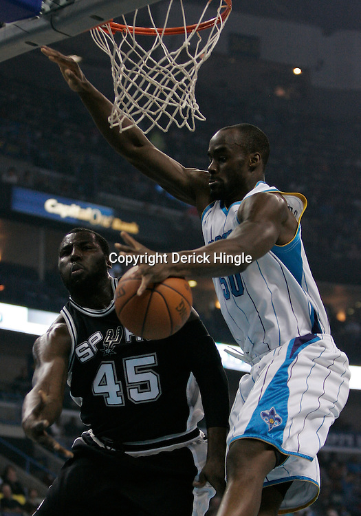 Mar 01, 2010; New Orleans, LA, USA; New Orleans Hornets center Emeka Okafor (50) deflects a pass by San Antonio Spurs forward DeJuan Blair (45)during the first half at the New Orleans Arena. Mandatory Credit: Derick E. Hingle-US PRESSWIRE
