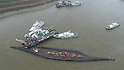JINGZHOU, CHINA - JUNE 02: (CHINA OUT) <br /> <br /> Ship Carrying 458 People Sinks In Yangtze River In Jingzhou<br /> <br /> Rescuers search for survivors from the capsized ship Dongfangzhixing in the Yangtze River on June 2, 2015 in Jingzhou, Hubei province of China. A passenger ship named Dongfangzhixing (Eastern Star) carrying 458 people, including 406 Chinese passengers, 5 travel agency workers and 47 crew members aboard, according to the administration, sank at around 9:28 p.m. on Monday in the Jianli (Hubei Province) section of the Yangtze River. The captain and the chief engineer in eight people have been rescued and both claimed that the ship sank quickly after being attacked by cyclone. Chinese President Xijinping has ordered a work team of the State Council to rush to the site to guide search and rescue work, and rescue teams of Hubei, Chongqing and relevant parties to carry out all-search efforts and properly handle the aftermath. <br /> ©Exclusivepix Media
