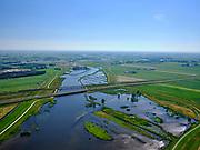 """Nederland, Overijssel, Gemeente Kampen; 21–06-2020; het Reevediep ter plaatse van natuurgebied De Enk. Voor de aanleg van het Reevediep liep ter hoogte van dit natuurgebied in Kamperveen het riviertje Reeve. In het midden Reevediepbrug(rijksweg N50) en Spoorbrug Reevediep (met trein), rivier de IJssel in de achtergrond.<br /> Het Reevediep is aangelegd in het kader van het project Ruimte voor de Rivier om bij hoogwater water af te voeren voordat dit het nabij gelegen Kampen bereikt, direct naar het IJsselmeer, de 'bypass Kampen'. Het Reevediepgebied is ook een natuurgebied en vormt een ecologische verbindingszone tussen rivier de IJssel en Drontermeer.<br /> Reevediep at the De Enk nature reserve. Before the construction of the Reevediep, the river Reeve ran near this nature reserve in Kamperveen.<br /> The Reevediep has been constructed as part of the Room for the River project, and functions to discharge high waters before reaching the nearby Kampen, directly to the IJsselmeer, the """"bypass Kampen"""". The Reevediep area is also a nature reserve and forms an ecological connecting zone between the river IJssel and Drontermeer.<br /> <br /> luchtfoto (toeslag op standaard tarieven);<br /> aerial photo (additional fee required)<br /> copyright © 2020 foto/photo Siebe Swart"""
