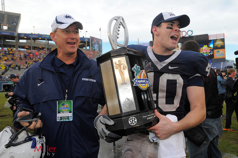 Jan. 1, 2010; Orlando, FL, USA; Penn State Nittany Lions center Andrew Pitz (40) carries the trophy off the field after the Nittany Lions 19-17 win over LSU Tigers in the 2009 Capital One Bowl at the Citrus Bowl. ©2010 Scott A. Miller