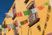 Mexican Papel Picado banners decorate a street during a festival in San Miguel de Allende, Guanajuato, Mexico.
