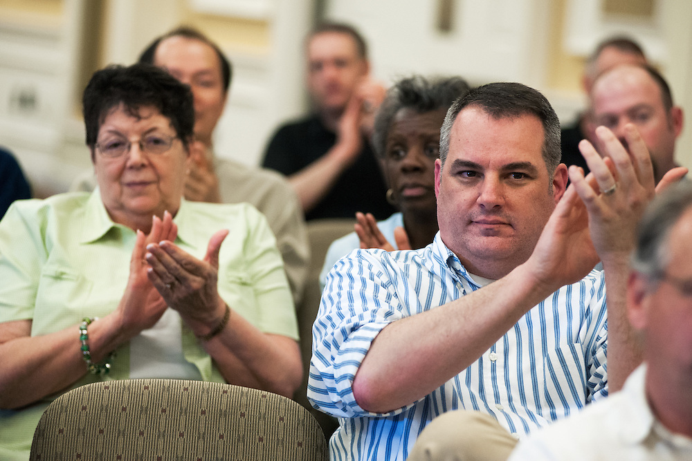 Mary Jones (left) and Greg Fialko (right) applaud as members ot the OU administrative staff recieve awards for their service. Photo by: Ross Brinkerhoff.