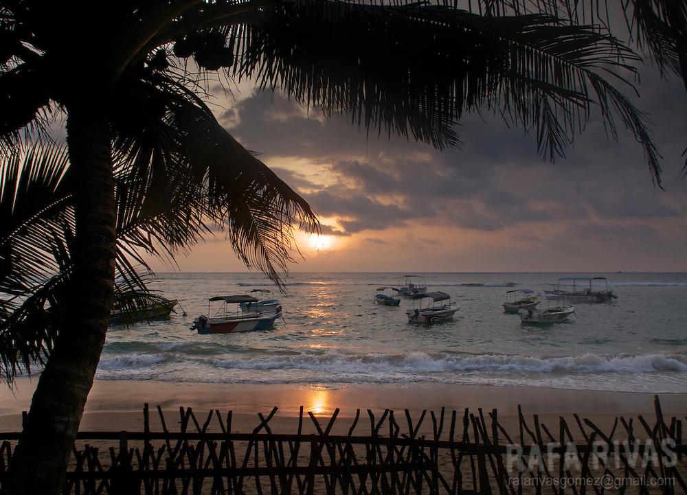Sun goes down in Hikkaduwa beach, Sri Lanka, on February 2011.