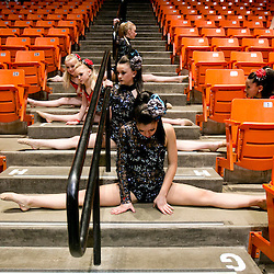 Members of the Eagle Rock Dance Platinum team stretch in a stairway before their audition for America's Got Talent at Taco Bell Arena. The group drove from Idaho Falls to audition for the show, joining thousands of other hopefuls who also auditioned. Tuesday February 10, 2015