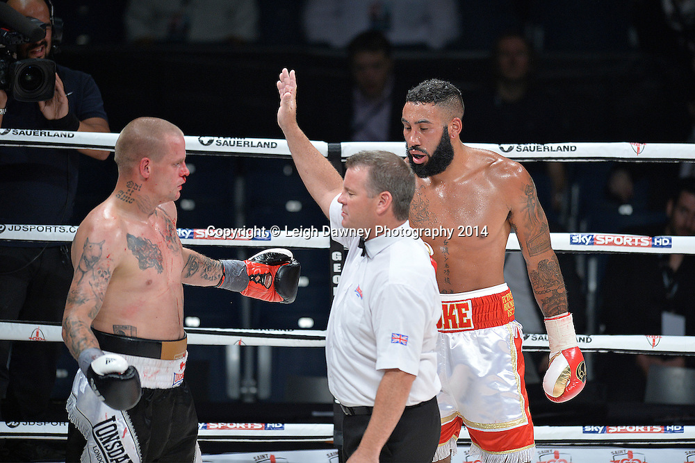 Referee stops the fight. David Vicena gestures in dismay over the decision against his stoppage against Luke Watkins (white/red shorts)  in a Cruiserweight contest at the SSE Wembley Arena, London on the 20th September 2014. Sauerland Promotions. Credit: Leigh Dawney Photography.