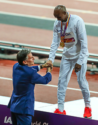 London, 2017-August-04. Lord Sebastian Coe congratulates Mo Farah on his gold medal  following his victory in the Men's 10,000m final at the IAAF World Championships London 2017. © Paul Davey.