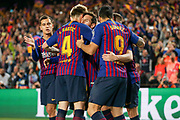 GOAL - 1-0 Barcelona forward Lionel Messi (10) celebrates  with Barcelona forward Luis Suarez (9)and Barcelona midfielder Ivan Rakitic (4) during the Champions League quarter-final leg 2 of 2 match between Barcelona and Manchester United at Camp Nou, Barcelona, Spain on 16 April 2019.