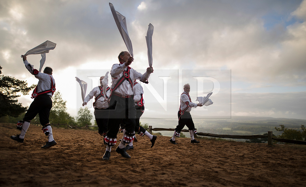 © Licensed to London News Pictures. 01/05/2017. Albury, UK. The Pilgrim Morris Men of Guildford dance at dawn on May Day on St Martha's Hill. Photo credit: Peter Macdiarmid/LNP