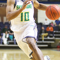 Freddie Jackson drives against Liberty Wednesday December 17, 2014 at Trask Coliseum on the campus of UNCW in Wilmington, N.C. (Jason A. Frizzelle)