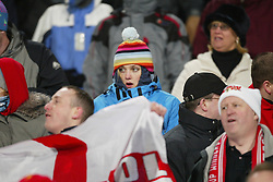 SOFIA, BULGARIA - Wednesday, March 3, 2004: Liverpool fans wrap up against the cold during the UEFA Cup 4th Round 2nd Leg match at the Vasil Levski Stadium. (Pic by David Rawcliffe/Propaganda)
