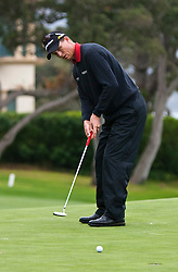 February 12, 2010; Pebble Beach, CA, USA; John Senden putts on the fourteenth hole during the second round of the AT&T Pebble Beach Pro-Am at Pebble Beach Golf Links.