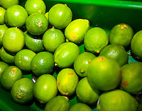 Close-up of green lemons on display in grocery store