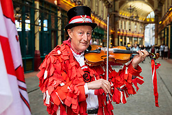 © Licensed to London News Pictures. 23/04/2018. London, UK. A violinist from the Ewell St Mary's Morris Men during a performance at a St George's Day celebration in Leadenhall Market. Photo credit: Rob Pinney/LNP