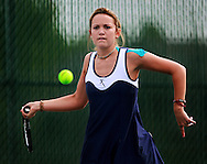 Xavier's Lisa Cowden, junior, eyes the ball as she returns it to Prairie's April McKeever (not pictured) during their match in the 1st round of the Regional Tennis Tournament at Xavier High School in Cedar Rapids on Saturday, May 15, 2010. Cowden defeated McKeever 6-0, 6-1 and Xavier defeated Prairie 5-0.
