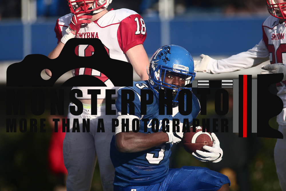 Running back Kedrick Whitehead (3) scores in the fourth quarter during the DIAA division one Football Championship game between Top-seeded Middletown (11-0) and second-seeded Smyrna (11-0) Saturday, Dec. 03, 2016 at Delaware Stadium in Newark.